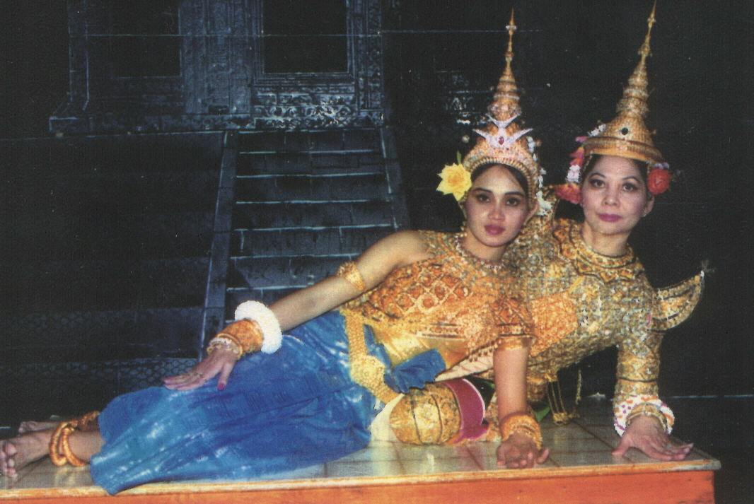 Dancers pose in court dance costumes